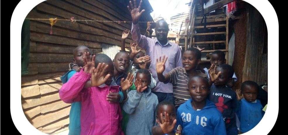 Kibera Slum GMFC WFF Children & Joseph banner Christian