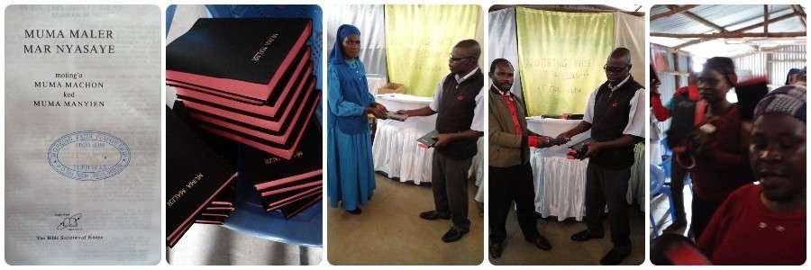 Brethren Receive The Word of God in Their Native Luo Language Banner - Kibera Slum Kenya